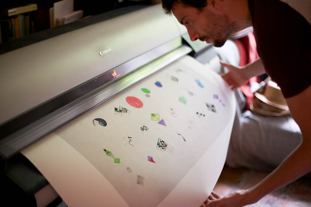 Inspecting the first ever DNArtwork print.